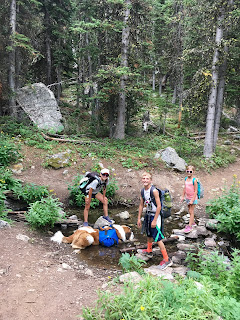 kids hiking in the mountains of montana
