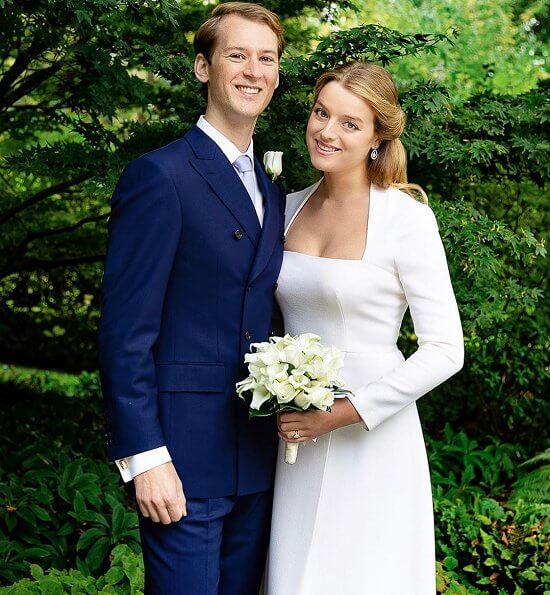 Flora Ogilvy wore a long sleeves, square neckline and crepe fabric wedding dress by Emilia Wickstead