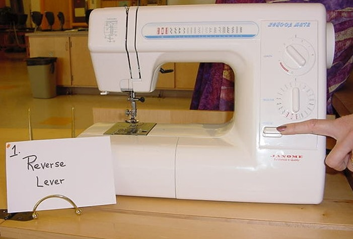 Reverse lever sewing machine