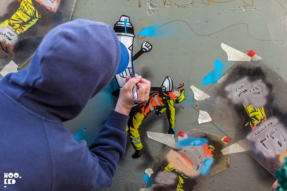French Street Artist OakOak at work on a stencil piece in Ostend, Belgium. Photo ©Hookedblog / Mark Rigney