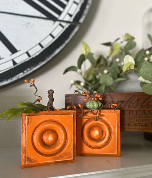 Orange block pumpkins on the mantel