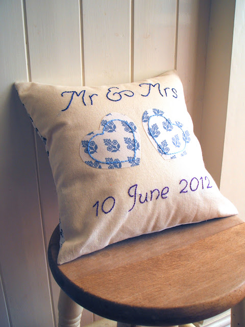 personalised handmade wedding cushion with vintage fabric hearts and embroidery