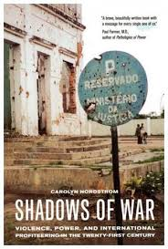 Shadows of War, Violence, Power, and International Profiteering in the Twenty-First Century