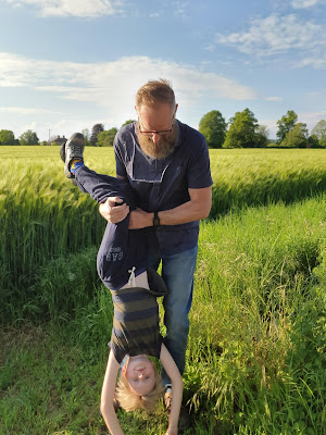 Dad playing with son in Barley field wearing clothes by Jacamo