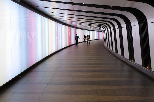 New pedestrian tunnel with integrated lightwall, One Pancras Square, King's Cross, London