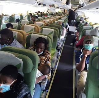 376 American nationals eventually evacuated from Nigeria to Washington DC (photos).