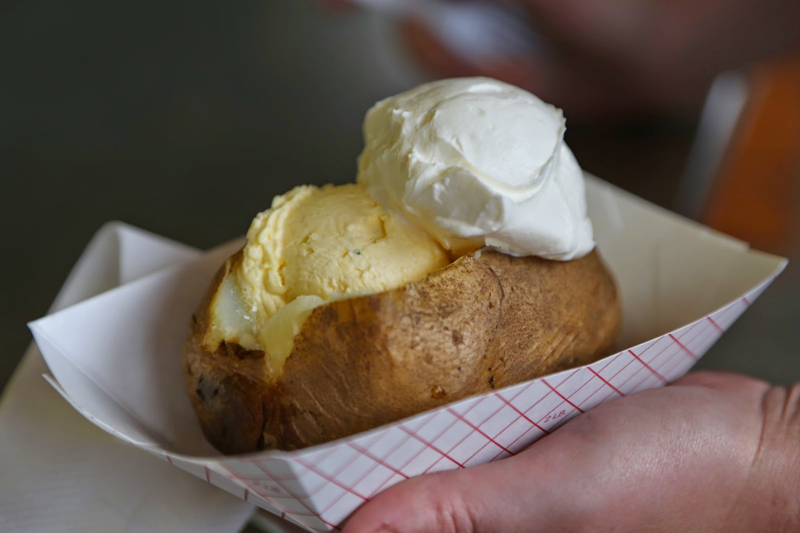 Baked potatoes with icecream scoops of cream cheese and whipped butter, Alaska State Fair