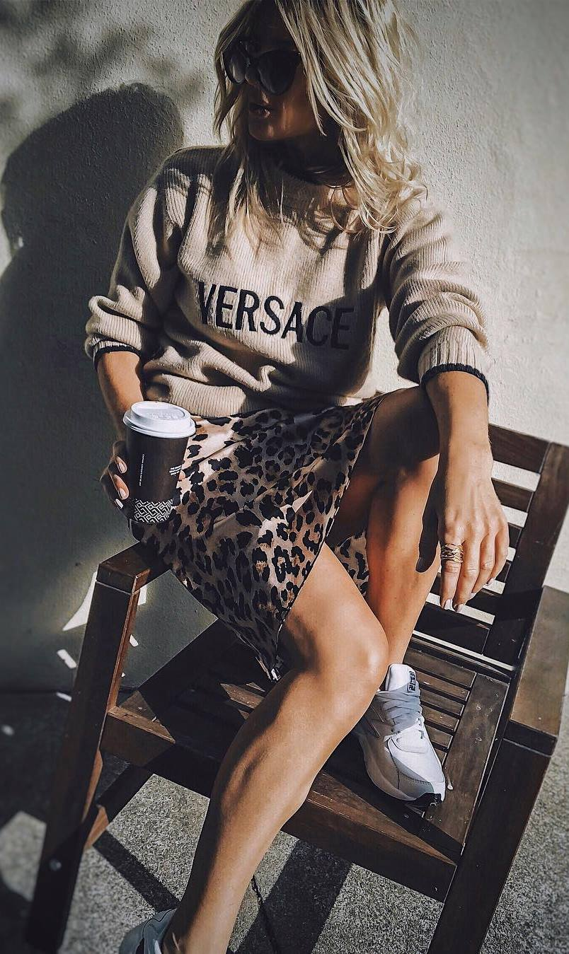 comfy fall outfit idea with a leopard skirt : sneakers and sweatshirt