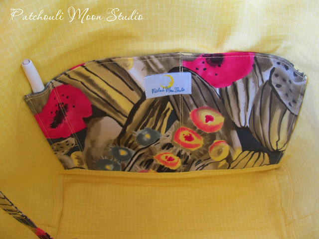 Lining of tote bag is bright yellow with cactus print slip pocket