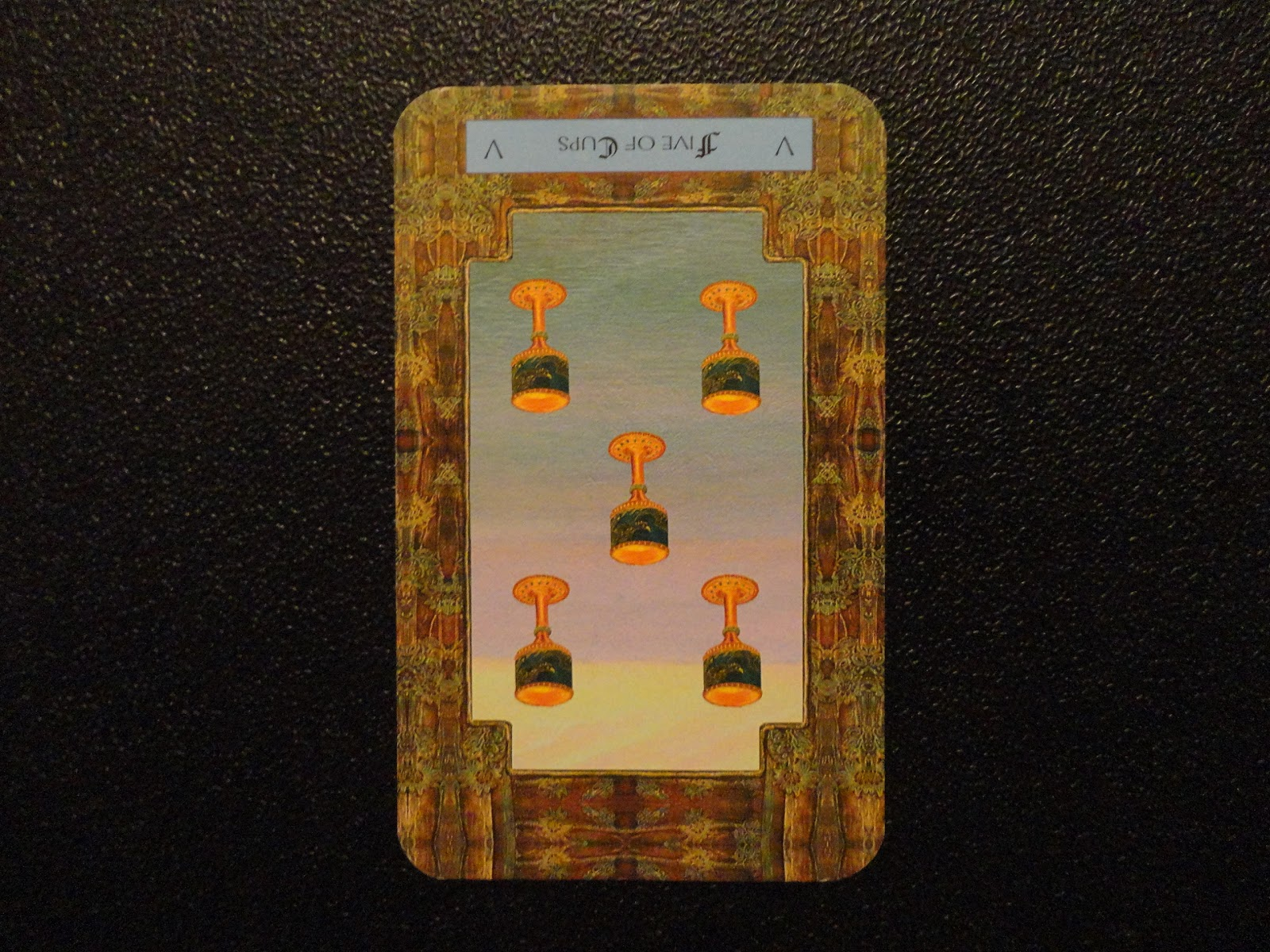 Reversed Five of Cups