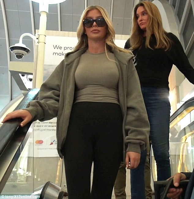 Sophia Hutchins flaunts her new boobs after undergoing breast enlargement surgery as she and Caitlyn Jenner arrive at LAX