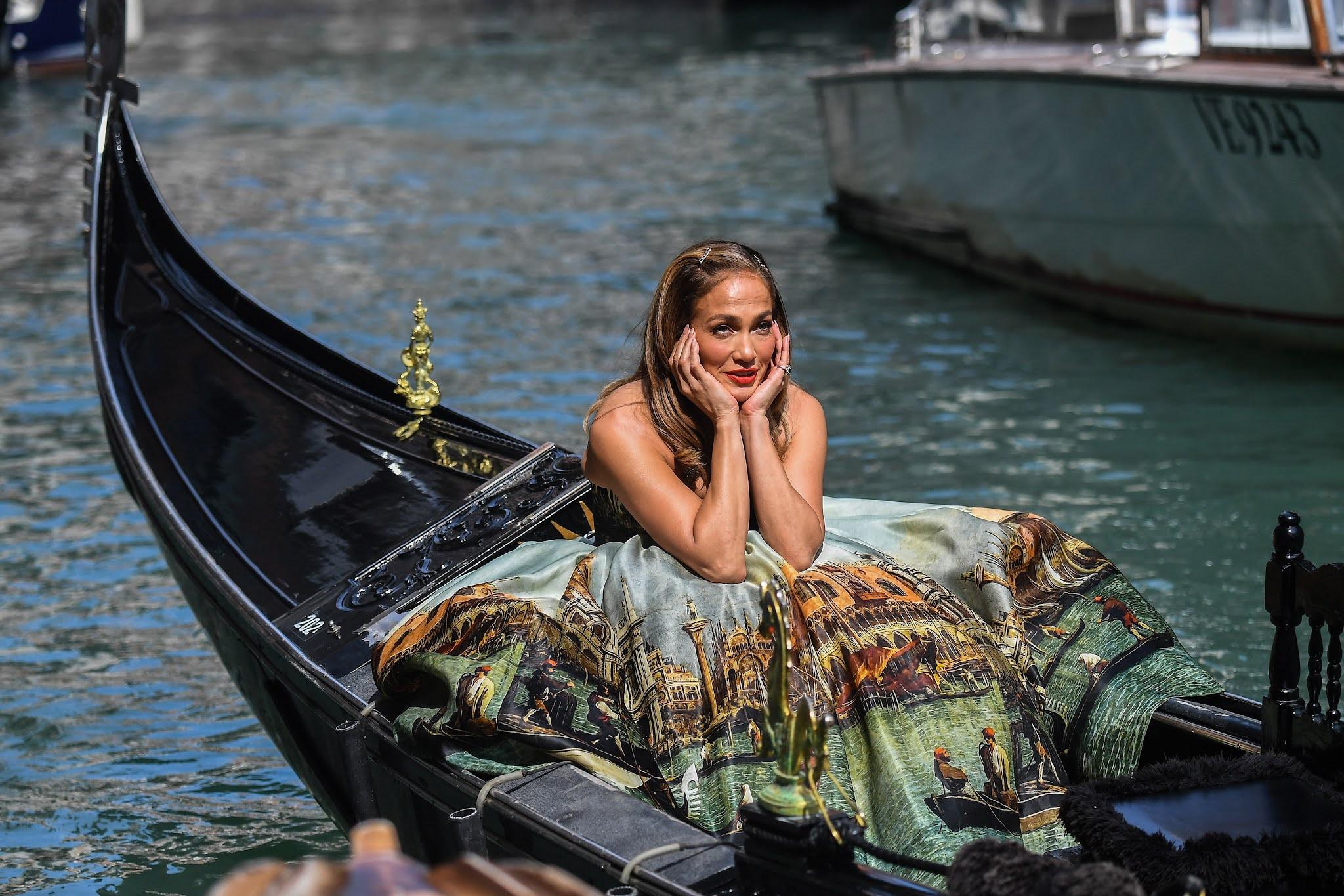 Jennifer Lopez stuns in a waist-cinching Dolce & Gabbana strapless tulle ballgown with a stunning print of Venice