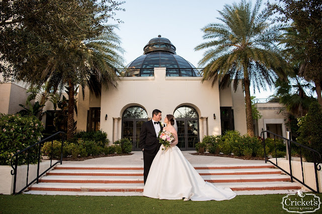 bride and groom on steps at The Alfond Inn