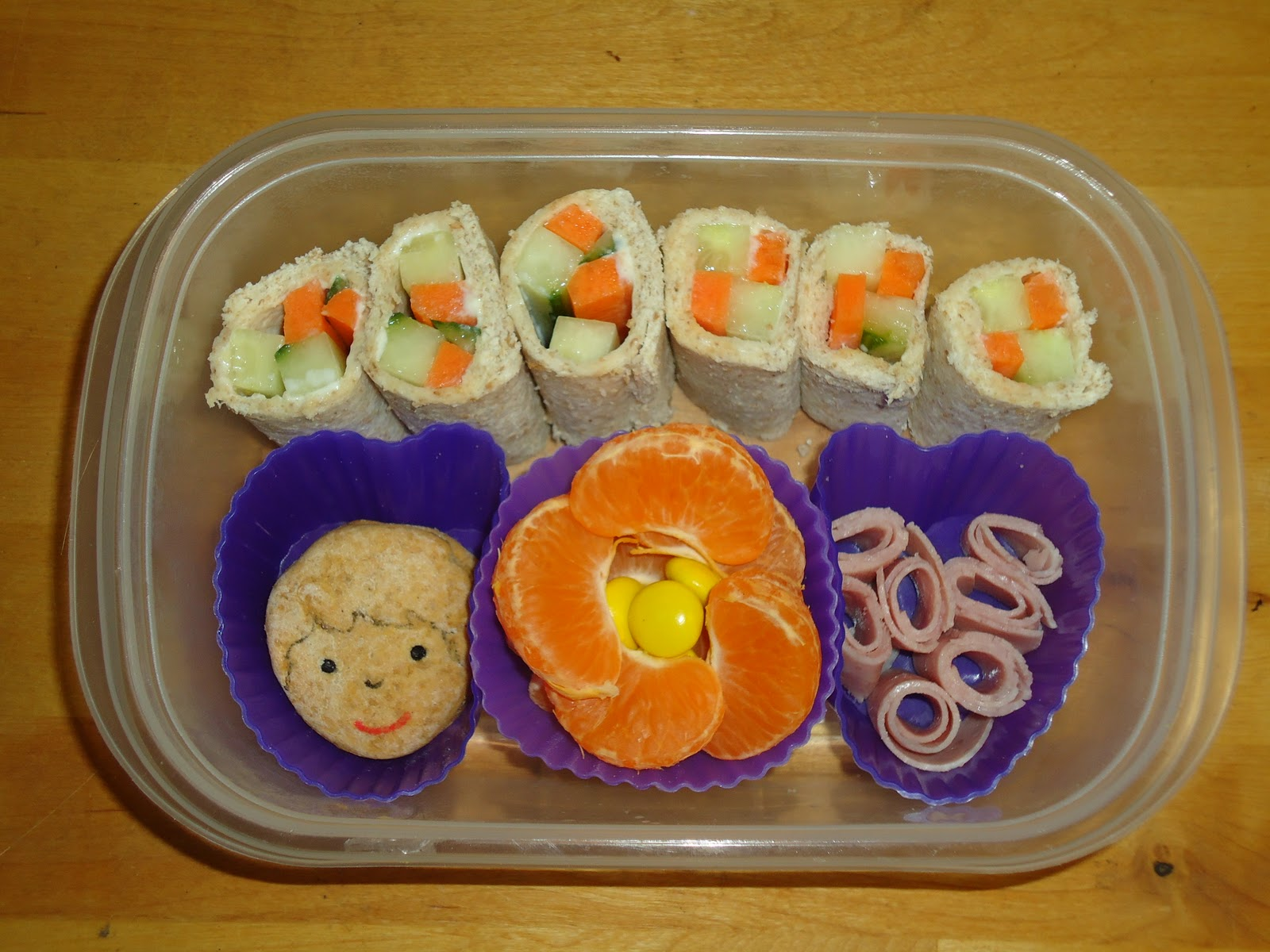 Some Sandwich Sushi, Ham roll ups, Nectraine Flower and Dan Jon Jr Biscuits