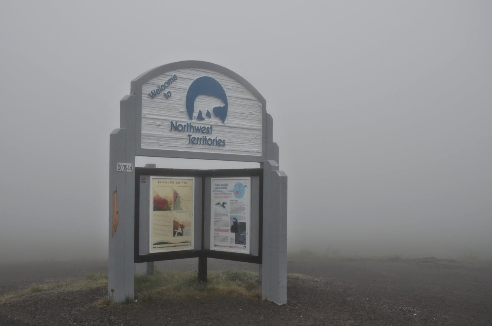 "Sign: ""Welcome to Northwest Territories"" fog is very thick."