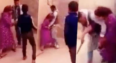 """فيديو صادم.. زوج """"يسلخ"""" زوجته بعصا و بطريقة وحشية أمام أبنائه الذين اكتفوا بالصراخ والاستنجاد"""