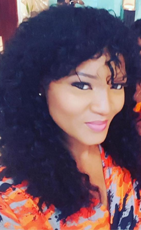 Omotola Jalade-Ekeinde looked exquisite in reception dinner of Nouva couture wrap dress