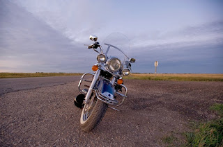 Image of a motorcycle on the highway, representing information about recalls given by Blue Ridge Riders of Asheville, NC