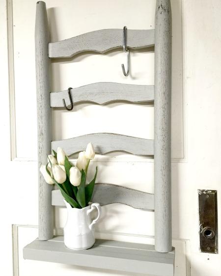 Grey ladder backed shelf with flowers