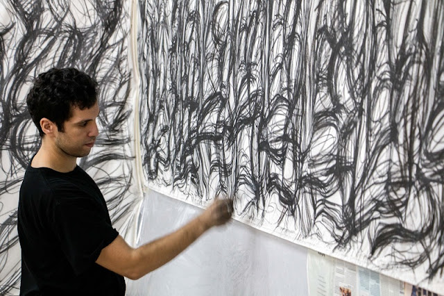 Artist Achraf Touloub working on his installation  'Untitled (Extended Feelings)' at Aspinwall House,Fort Kochi.