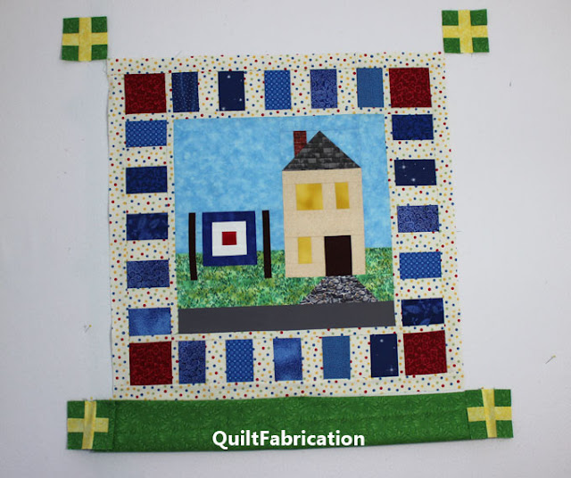 yellow and green plus sign blocks in the quilt corners