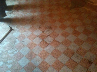 renovation project restoring old floor tiles