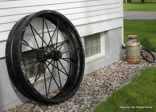 tractor wheel, garden junk, old schoolhouse, http://bec4-beyondthepicketfence.blogspot.com/2016/05/junk-planters.html