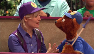 Gina and Baby Bear are also watching Pogo Games to support. Sesame Street Episode 4421, The Pogo Games, Season 44.