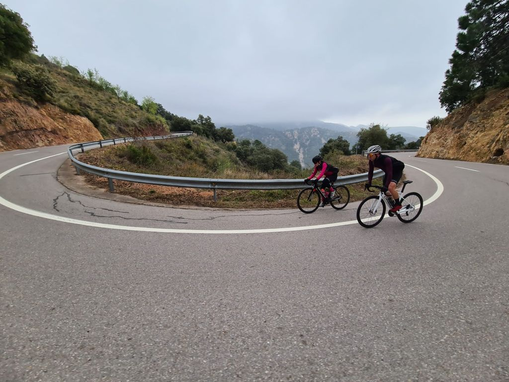 Cyclists nearing the summit of Port d'Eslida, Castellón, Spain