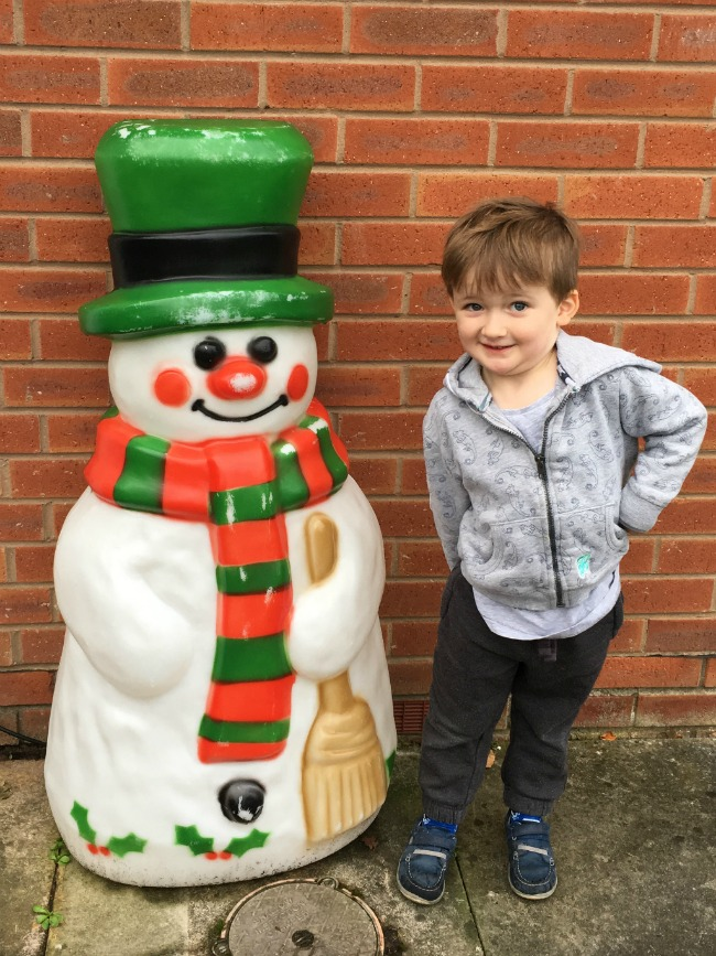 Our-Weekly-Journal-Naughty-and-Nice-boy-with-snowman-decoration