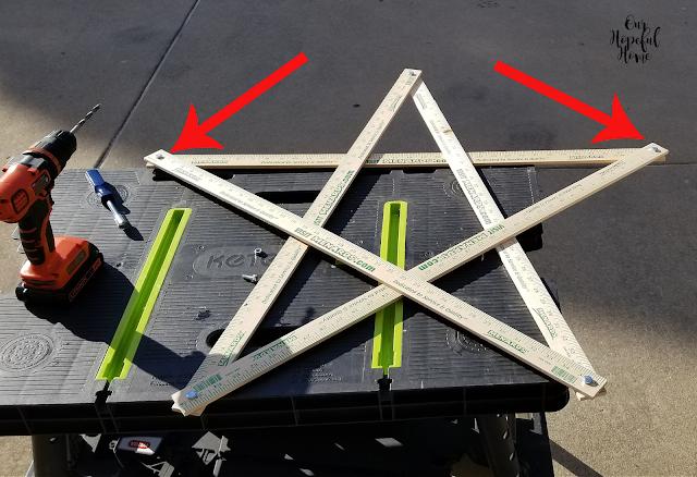five wooden yard sticks star shape