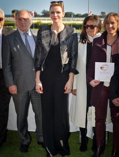 Princess Charlene wearing an Akris Ilka Jockey Jacquard Short Jacket and Akris Silk Crepe Jumpsuit