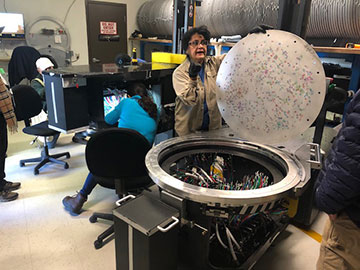 Technicians preparing and plugging fiber optic cables in disk for use that evening (Source: Palmia Observatory)
