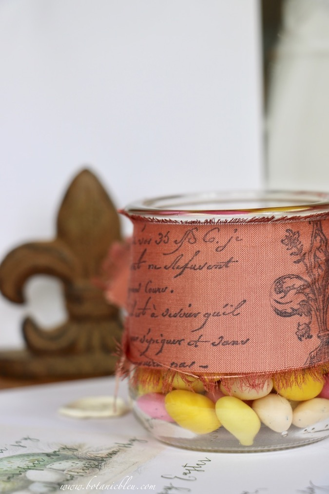 Recycled yogurt glass jars with handmade French stamped silk ribbon are perfect for displaying French made fruit jelly candy eggs