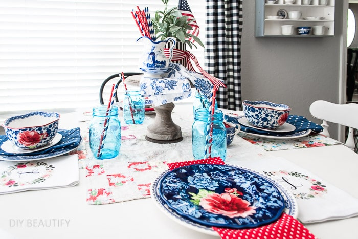 vintage and collected dishes on a patriotic tablescape
