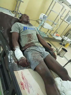 kay's report: Nigerian lady demands justice for her cousin who sustained a gunshot injury after he was attacked by SARS officials in Abuja Yesterday (Photos)