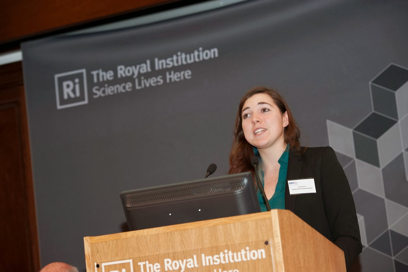 Cait Percy on stage at the Royal Institution. Photograph by Paul Stead Photography.