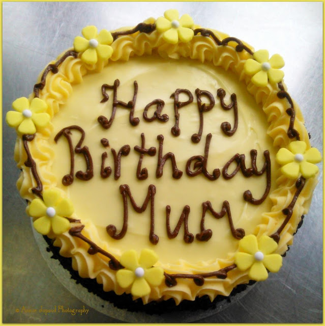 lemon buttercream cake with the sign 'Happy Birthday Mum""