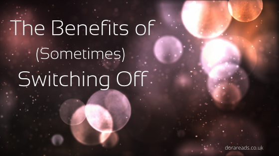 'The Benefits of (Sometimes) Switching Off' against an artsy black-and-lens-flare background