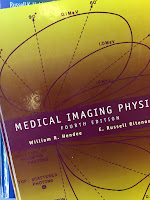 Medical Imaging Physics, by Hendee and Ritenour, superimposed on Intermediate Physics for Medicine and Biology.
