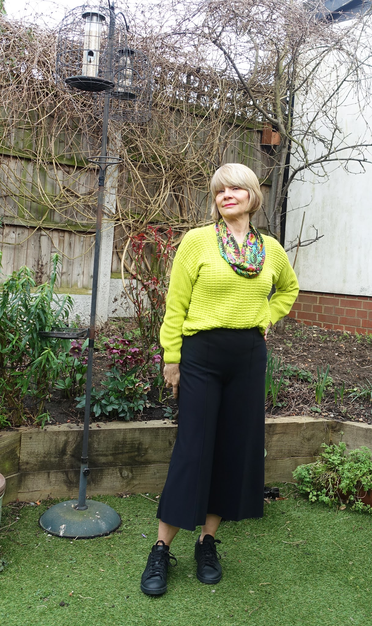 A jumper, scarf and culottes makes a stylish casual outfit with a nod to spring with lime green and bright colors of Samoa