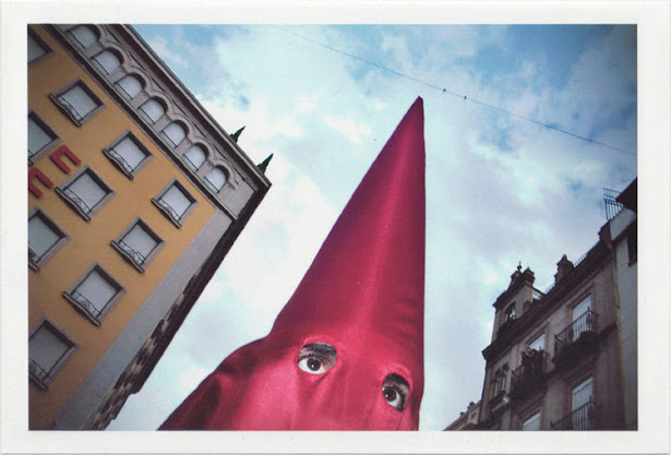 dirty photos - Once - street photo of kukluxklan red costume in sevilla