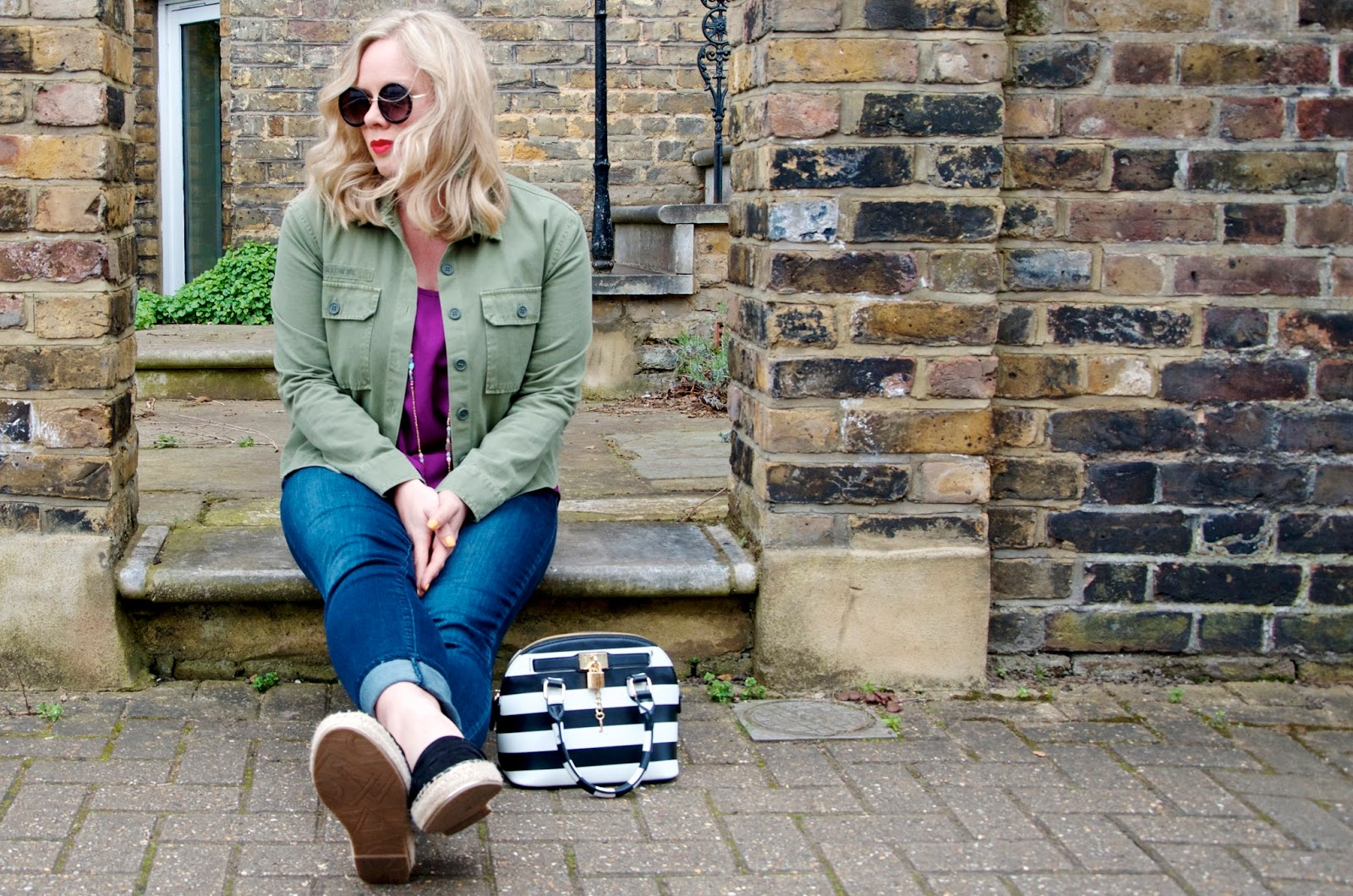 green utility jacket and striped bag