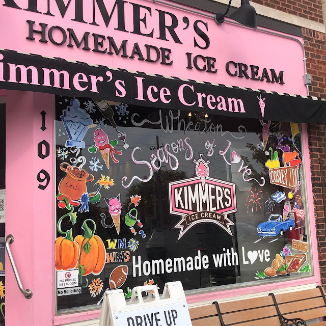 Kimmer's window art paints a whimsical ode to Wheaton fun.