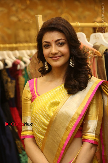 Actress Kajal Agarwal Stills in Golden Silk Saree at Trisha Sesigner Store Launch  0019.jpg