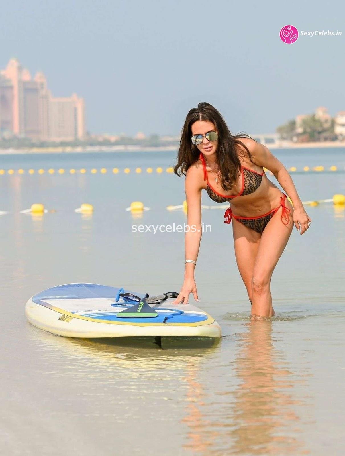 Danielle Lloyd ultra Sexy body huge tits sexy ass in tiny bikini WOW Beach Side Hot Pics
