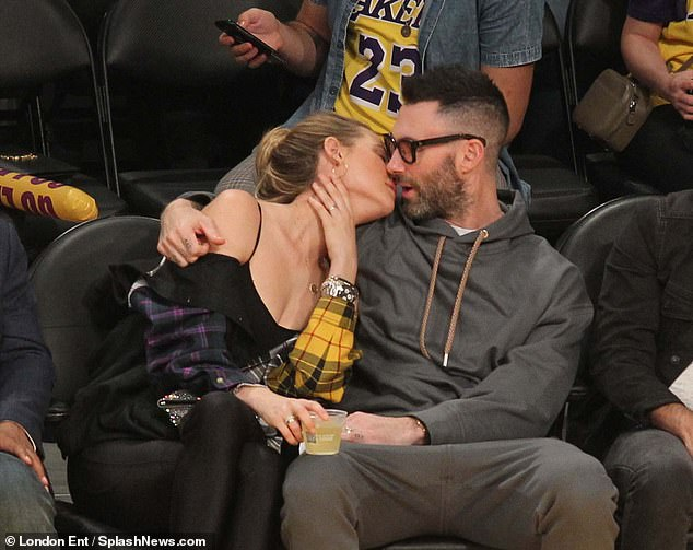 Adam Levine and Behati Prinsloo pack on the PDA at the LA Lakers game