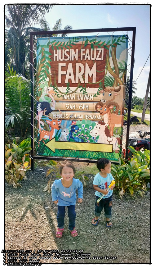 Husin Fauzi Farm. Zoo. Hours of operation 9 a.m. to 6 p.m. Buying and selling livestock. Aina's stylish picture in front of the viewer of Husin Fauzi Farm while Aidan is busy noticing something. Pictured before we moved to leave the farm.