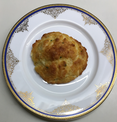 Photo of keto cheddar-chive biscuit on a small plate