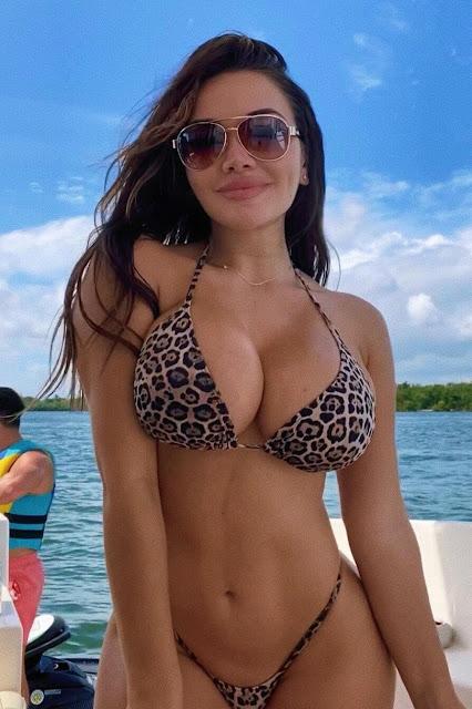 beautiful fit Woman big tits leopard Bikini On A Boat